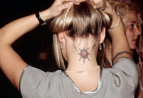 Sun Tattoo on Woman's Neck