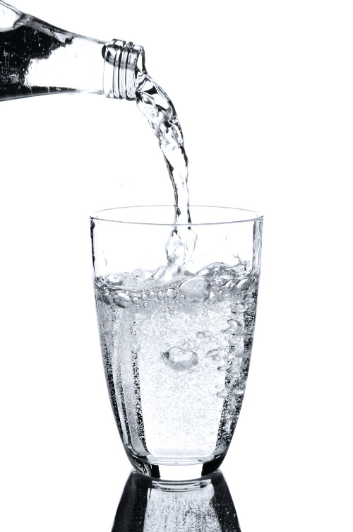 mineral water being porued into a glass