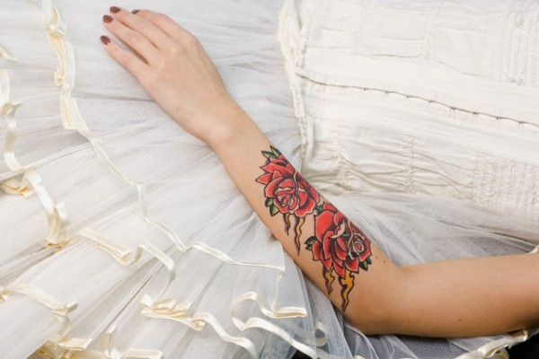 Bride With Tattoo on Forearm --- Image by © Ragnar Schmuck/Corbis