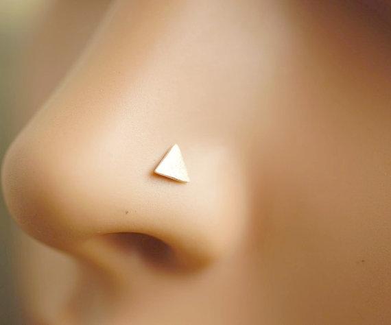 piercing triangulo