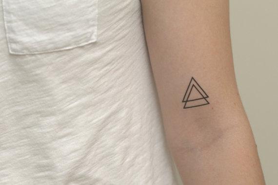 triangulo tatuaje